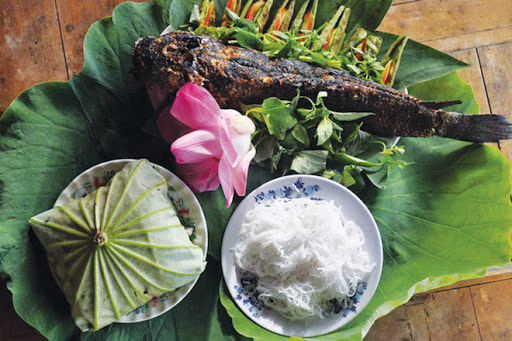 COME DONG THAP- ENJOY  GRILLED SNAKEHEAD FISH ROLLED IN YOUNG LOTUS LEAF